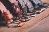 Leather Belts On A Wooden Background. Fashionable Leather Belts. poster