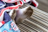 Pair Of Child Feet In Dirty Stained White Socks. Kid Soiled Socks While Playing Outdoors. Children C poster