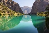 Beautiful serene lake in  Fann mountains (branch of Pamir) in Tajikistan. poster