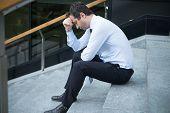 Portrait Of Desperate Businessman In Big Trouble Feeling Lost poster