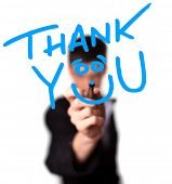 stock photo of thank you card  - Young man writing Thank YOU on whiteboard - JPG
