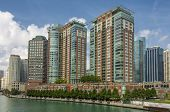 A Group Of Colorful High Rise Apartments Overlooking The Chicago River In Downtown Chicago, Illinois poster