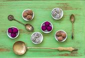 Flat Lay Of Brass Antique Indian Spoons With Bliss Balls poster