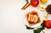 Toast With A Crushed Apple Jam, Slices Of Fresh Apples, Cinnamon On A Plate On A White Table. Apples poster