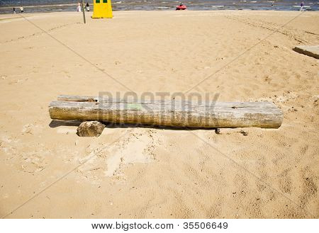 Old Broken Wooden Bench In Sea Sand. People Relax
