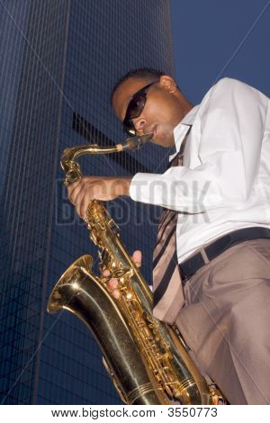 Urban Saxophone Player On Skyscraper Background