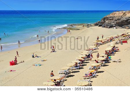FUERTEVENTURA, SPAIN - JUNE 22: Esmeralda Beach on June 22, 2012 in Fuerteventura, Canary Islands, Spain. This white sand beach with turquoise water is named after the nearby hotel Playa Esmeralda