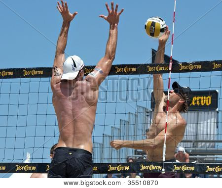 HERMOSA BEACH, CA - JULY 21: Stein Metzger and Sean Scott compete in the Jose Cuervo Pro Beach Volleyball tournament in Hermosa Beach, CA on July 21, 2012.