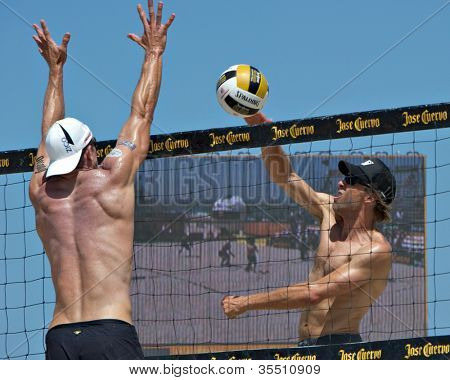 HERMOSA BEACH, CA - JULY 21: John Hyden and Stein Metzger compete in the Jose Cuervo Pro Beach Volleyball tournament in Hermosa Beach, CA on July 21, 2012.