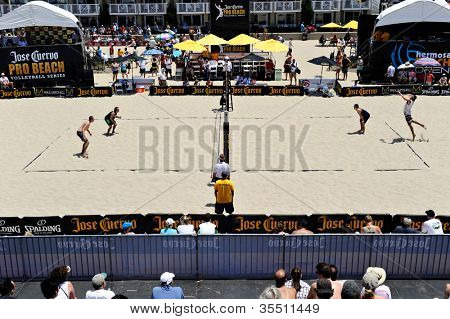 HERMOSA BEACH, CA - JULY 21: Brad Keenan, John Mayer, Mark van Zwieten and Andrew Fuller compete in the Jose Cuervo Pro Beach Volleyball tournament in Hermosa Beach, CA on July 21, 2012.