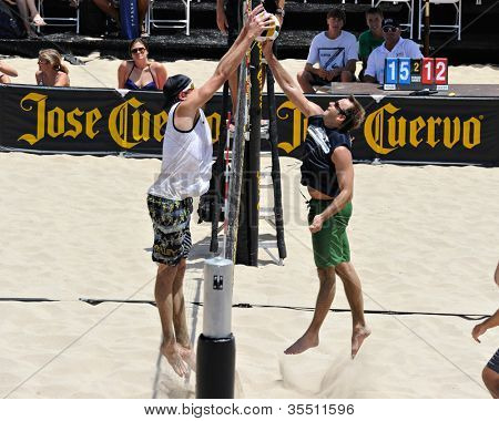 HERMOSA BEACH, CA - JULY 21: Brad Keenan and John Mayer compete in the Jose Cuervo Pro Beach Volleyball tournament in Hermosa Beach, CA on July 21, 2012.