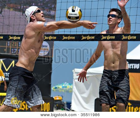 HERMOSA BEACH, CA - JULY 21: Mark Williams and Sean Scott  compete in the Jose Cuervo Pro Beach Volleyball tournament in Hermosa Beach, CA on July 21, 2012.