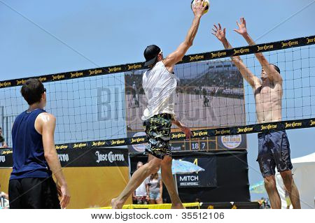 HERMOSA BEACH, CA - JULY 21: Andrew Fuller, Brad Keenan and John Mayer compete in the Jose Cuervo Pro Beach Volleyball tournament in Hermosa Beach, CA on July 21, 2012.