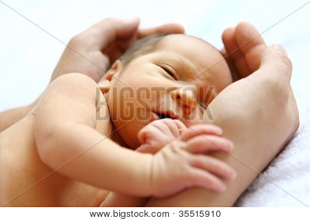 Baby in father's hands