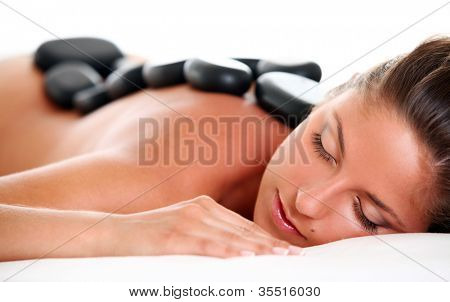 Beautiful woman enjoying a hot stone massage