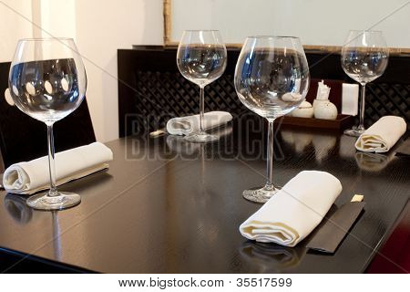 Glasses wine on table in sushi restaurant