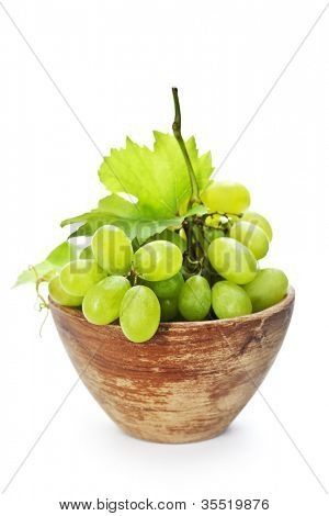 Fresh grape in old bowl isolated on white