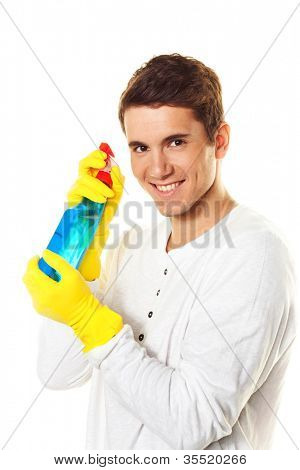 man with cleaning fluid. cleaning the apartment. hausmannbei apartment cleaning in spring