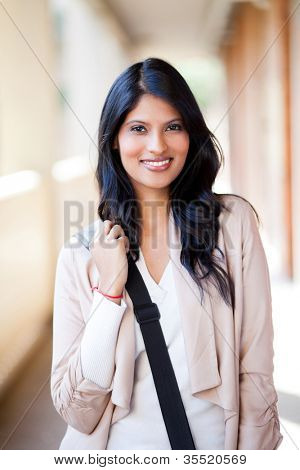 beautiful female college student with shoulder bag