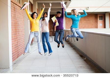 group of female college students jumping up