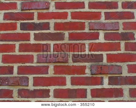 Two Tone Brick Wall With Protruding Bricks