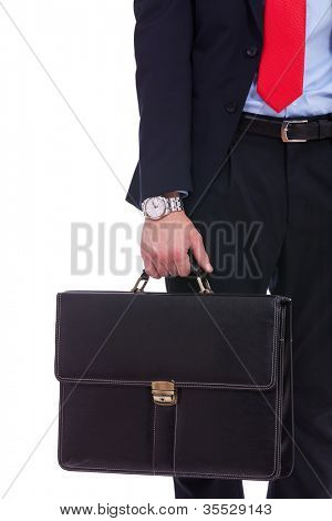 Business man in black suit hand holding briefcase  on white background