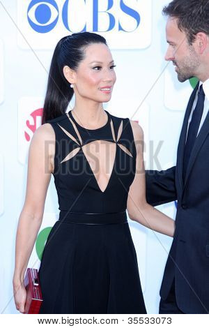 LOS ANGELES - JUL 29:  Lucy Liu, Jonny Lee Miller arrives at the CBS, CW, and Showtime 2012 Summer TCA party at Beverly Hilton Hotel Adjacent Parking Lot on July 29, 2012 in Beverly Hills, CA