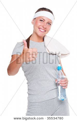 studio shot of healthy young woman showing thumbs up. isolated on white background
