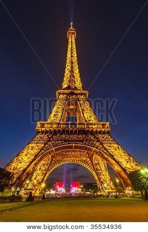 PARIS - MAY 22: Eiffel Tower brightly illuminated at dusk on May 22, 2008 in Paris. The Eiffel tower is the most visited monument of France.