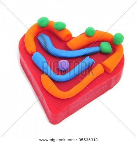 a colorful heart made with plasticine of different colors on a white background