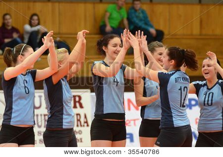 KAPOSVAR, HUNGARY - MARCH 16: Kaposvar players celebrate at the Hungarian Championship volleyball game Kaposvar (blue) vs Palota (deep blue), March 16, 2012 in Kaposvar, Hungary