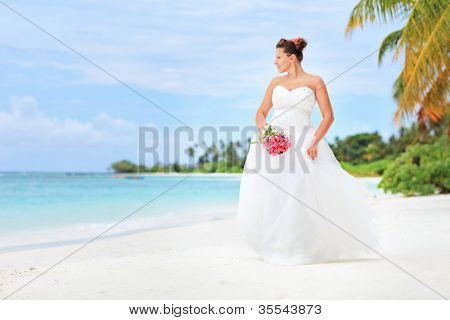 A bride posing on a beach in Kuredu resort, Maldives island, Lhaviyani atoll