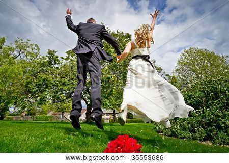 Happiness jump of bride and groom