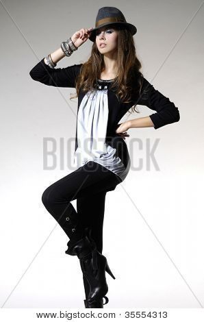 Fashion photo, a model is posing over light background