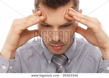 Closeup portrait of troubled businessman, looking down, having headache.