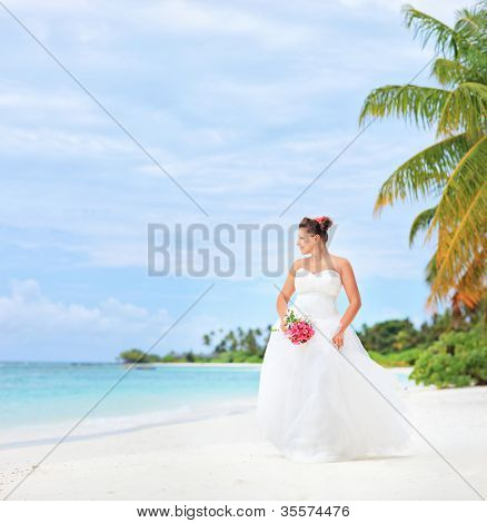 A bride on a beach in Kuredu resort, Maldives island, Lhaviyani atoll