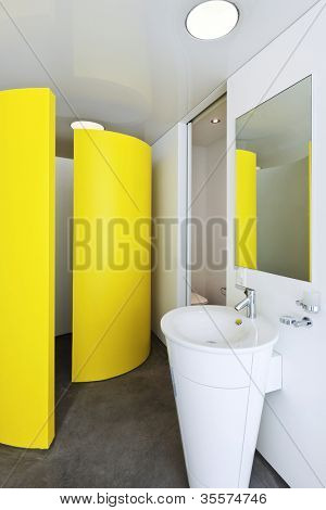 Bathroom with a colored shower cubicle in hotel