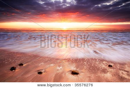 Glorious Sunset lights up the surf