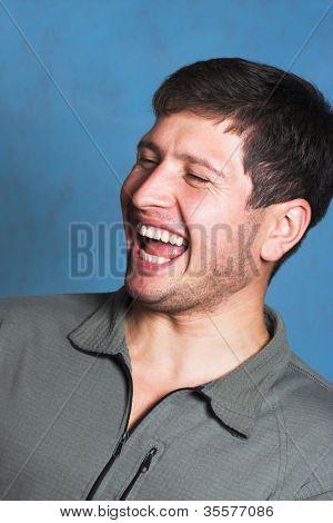 Young beautiful laughing brunette closeup