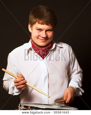 young drummer over black background