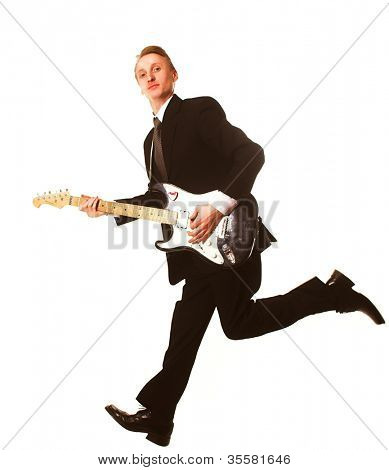 Young man jumping with guitar
