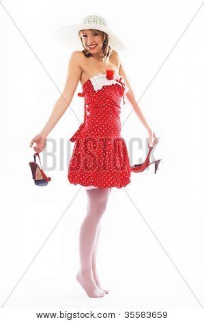 classical pin-up image of lovely girl in red dress over white