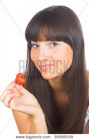 brunette girl eating a strawberry