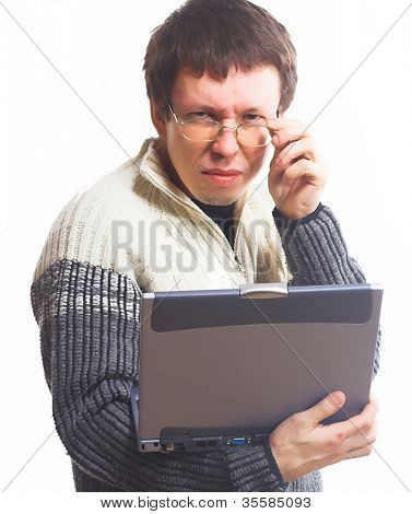 young man using a laptop computer - isolated over white