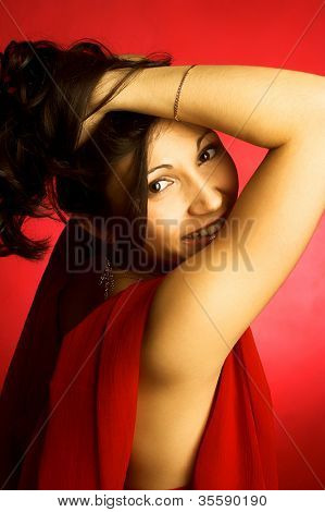 beautiful girl  smiling over red background