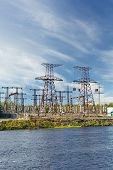 image of hydro-electric  - Electric power transmission on hydroelectric station on blue sky - JPG