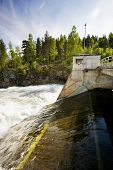 picture of hydro-electric  - A hydro electric plant on a river - JPG