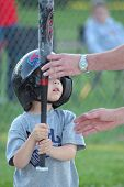 stock photo of little-league  - boy getting help from his dad while up to bat at little league baseball - JPG
