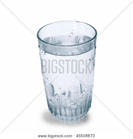 glass cup of pure water on a blue background