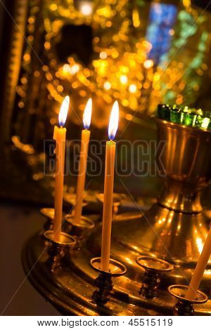 lighting candles in russian orthodox church